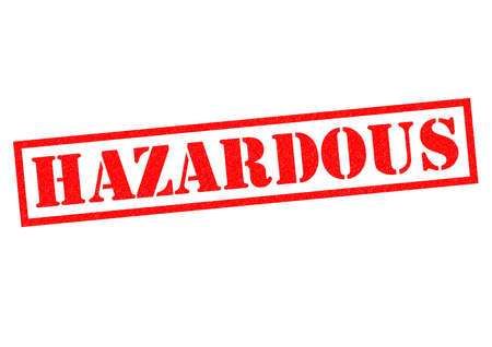 warned: HAZARDOUS red Rubber Stamp over a white background.
