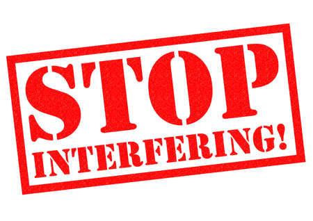 hinder: STOP INTERFERING! red Rubber Stamp over a white background. Stock Photo