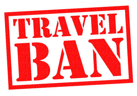 banning the symbol: TRAVEL BAN red Rubber Stamp over a white background. Stock Photo