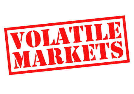 unsettled: VOLATILE MARKETS red Rubber Stamp over a white background.