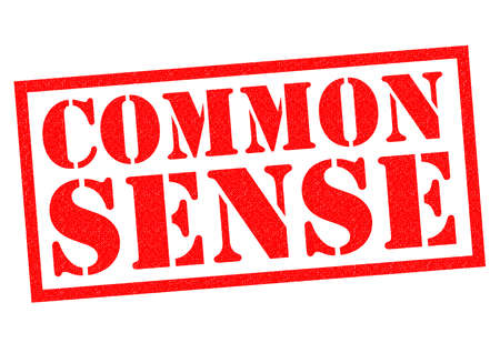 in common: COMMON SENSE red Rubber Stamp over a white background. Stock Photo