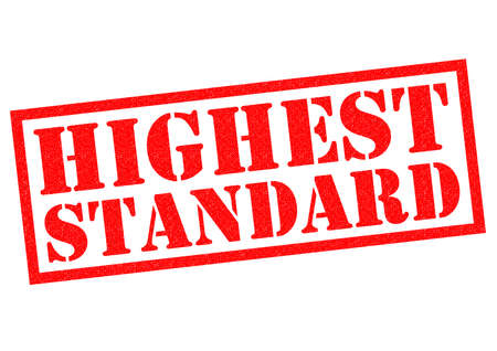 highest: HIGHEST STANDARD red Rubber Stamp over a white background. Stock Photo