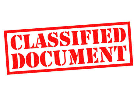 revealed: CLASSIFIED DOCUMENT red Rubber Stamp over a white background. Stock Photo