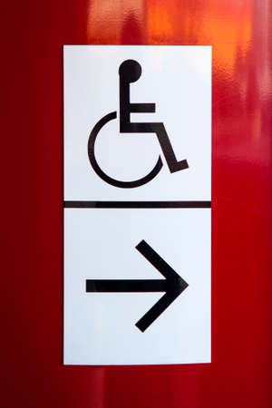 notifying: A sign notifying the nearest Disabled facilities and access. Stock Photo