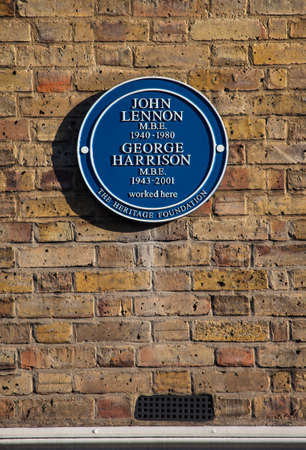 blue plaque: LONDON, UK - JANUARY 19TH 2016: A blue plaque marking the former location of The Beatles' defunct Apple Boutique shop on Baker Street in London, on 19th January 2016. Editorial