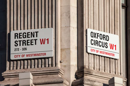 hectic: LONDON, UK - JANUARY 19TH 2016: Street signs for Regent Street and Oxford Circus in central London, on 19th January 2016.