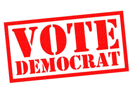 primaries: VOTE DEMOCRAT red Rubber Stamp over a white background.
