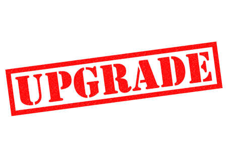 improved: UPGRADE red Rubber Stamp over a white background. Stock Photo