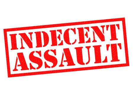 assault: INDECENT ASSAULT red Rubber Stamp over a white background.