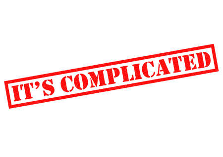 puzzling: IT�S COMPLICATED red Rubber Stamp over a white background. Stock Photo