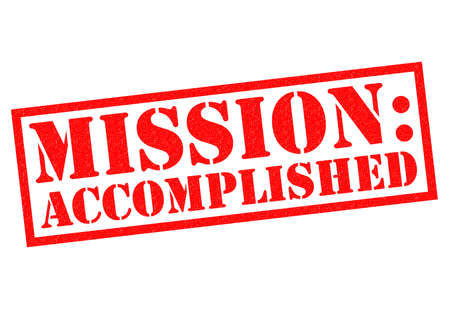 triumphant: MISSION ACCOMPLISHED red Rubber Stamp over a white background. Stock Photo