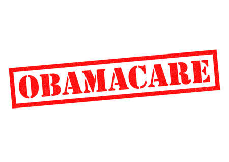 tax policy: OBAMACARE red Rubber Stamp over a white background.