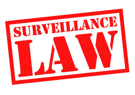 closed circuit television: SURVEILLANCE LAW red Rubber Stamp over a white background.