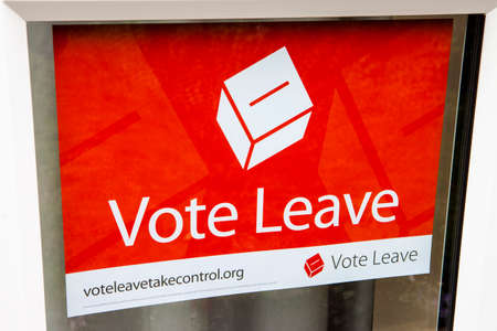 LONDON, UK - MARCH 3RD 2016: A Vote Leave campaign poster displayed in a residential house in London, on 3rd March 2016.  A referendum on Britains membership of the European Union will be held on Thursday 23 June 2016. Редакционное