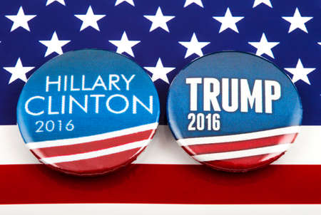 LONDON, UK - MARCH 3RD 2016: Hillary Clinton and Donald Trump pin badges over the American flag, symbolizing their battle to become the next President of the United States, 3rd March 2016. 에디토리얼