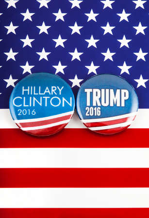 LONDON, UK - MARCH 3RD 2016: Hillary Clinton and Donald Trump pin badges over the American flag, symbolizing their battle to become the next President of the United States, 3rd March 2016. Editorial