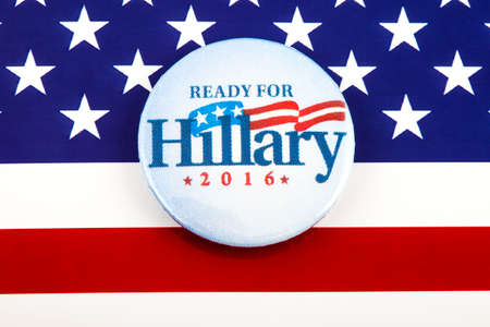 primaries: LONDON, UK - MARCH 3RD 2016: A Hillary Clinton 2016 pin badge over the US flag symbolising her campaign to become the next President of the United States, 3rd March 2016.