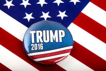 primaries: LONDON, UK - MARCH 3RD 2016: A Trump 2016 pin badge over the US flag symbolising Donald Trump's campaign to become the next President of the United States, 3rd March 2016. Editorial