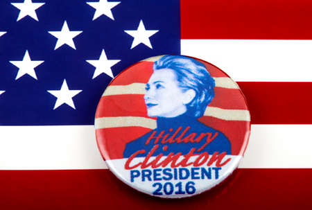 primaries: LONDON, UK - MARCH 3RD 2016: A Hillary Clinton 2016 pin badge over the US flag symbolizing her campaign to become the next President of the United States, 3rd March 2016.