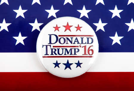 primaries: LONDON, UK - MARCH 3RD 2016: A Trump 2016 pin badge over the US flag symbolizing the Donald Trump campaign to become the next President of the United States, 3rd March 2016.