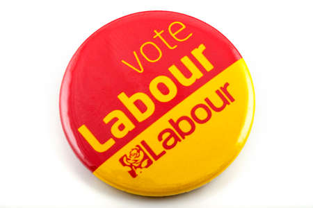 mayoral: LONDON, UK - MARCH 3RD 2016: A VOTE LABOUR pin badge over a white background, on 3rd March 2016.