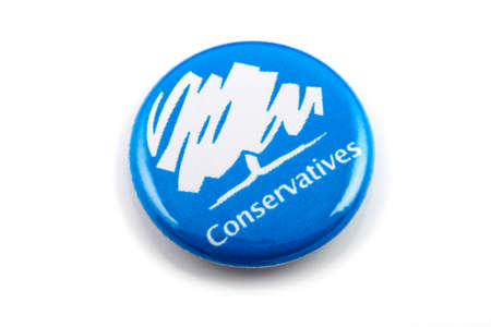LONDON, UK - MARCH 3RD 2016: A Conservatives (Conservative Party) pin badge over a white background, on 3rd March 2016.