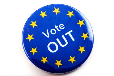 refers: LONDON, UK - MARCH 3RD 2016: A VOTE OUT pin badge over a white background, on 3rd March 2016.  The badge refers to the upcoming referendum regarding UK's membership in the European Union. Editorial