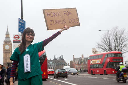 government services: LONDON, UK - APRIL 6TH 2016: Junior Doctors from St. Thomas' Hospital in London taking part in a fourth walkout in their contract dispute with the government, on 6th April 2016. Editorial