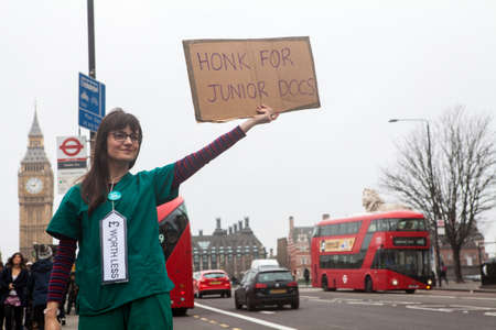 nhs: LONDON, UK - APRIL 6TH 2016: Junior Doctors from St. Thomas' Hospital in London taking part in a fourth walkout in their contract dispute with the government, on 6th April 2016. Editorial