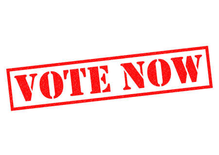 vote here: VOTE NOW red Rubber Stamp over a white background.