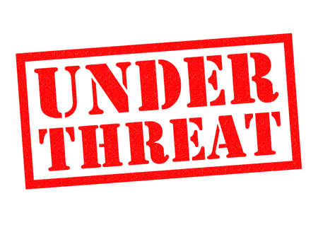 the threat: UNDER THREAT red Rubber Stamp over a white background.