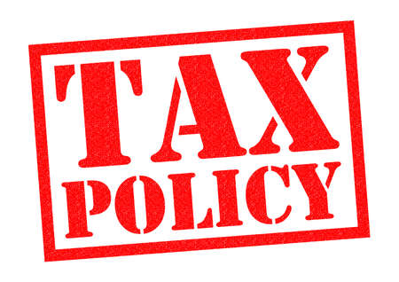 macroeconomic: TAX POLICY red Rubber Stamp over a white background. Stock Photo