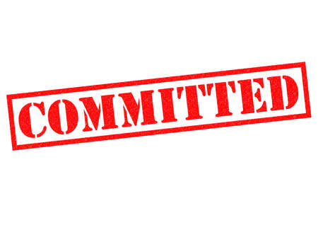 commitment committed: COMMITTED red Rubber Stamp over a white background. Stock Photo