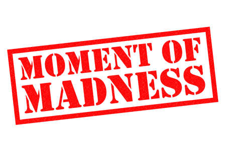 foolishness: MOMENT OF MADNESS red Rubber Stamp over a white background. Stock Photo