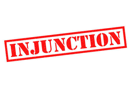 ruling: INJUNCTION red Rubber Stamp over a white background. Stock Photo