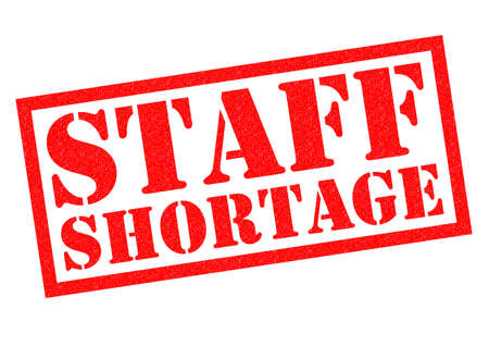staffing: STAFF SHORTAGE red Rubber Stamp over a white background.