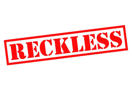 reckless: RECKLESS red Rubber Stamp over a white background. Stock Photo
