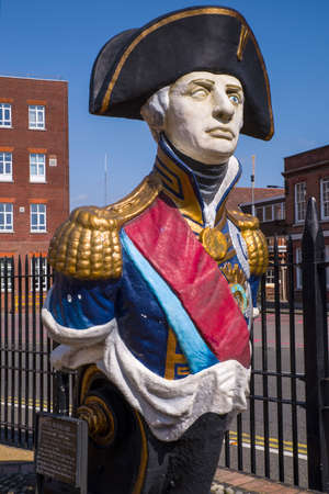 dockyard: A monument of Lord Nelson located in the historic dockyard in Portsmouth, UK.