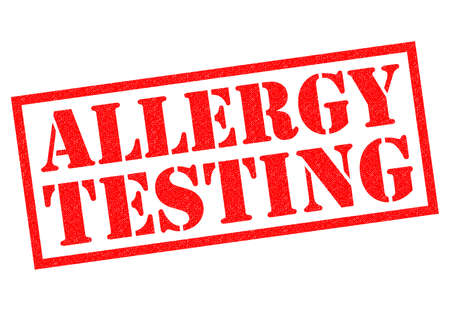 intolerant: ALLERGY TESTING red rubber Stamp over a white background. Stock Photo