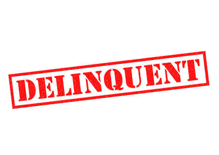 delinquency: DELINQUENT red Rubber Stamp over a white background. Stock Photo