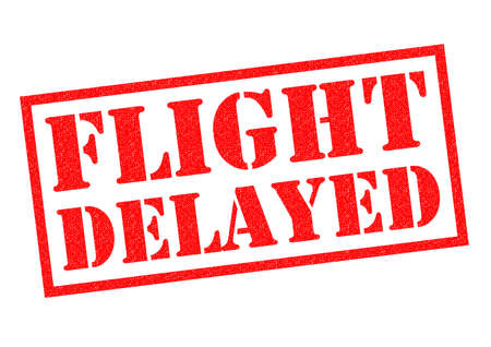 delaying: FLIGHT DELAYED red Rubber Stamp over a white background. Stock Photo