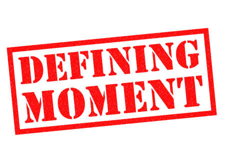 moment: DEFINING MOMENT red Rubber Stamp over a white background. Stock Photo