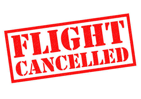 delaying: FLIGHT CANCELLED (British spelling) red Rubber Stamp over a white background. Stock Photo