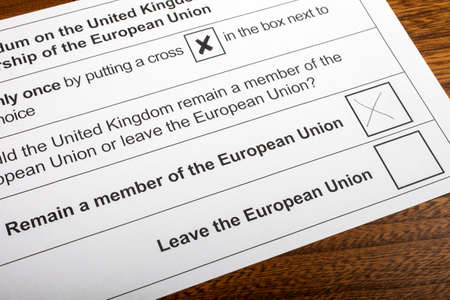 remain: LONDON, UK - JUNE 13TH 2016: The EU Referendum Ballot Paper, with a cross next to the option for the UK to Remain a member of the European Union, taken on 13th June 2016.