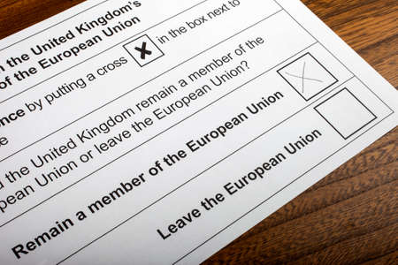 common market: LONDON, UK - JUNE 13TH 2016: The EU Referendum Ballot Paper, with a cross next to the option for the UK to Remain a member of the European Union, taken on 13th June 2016.
