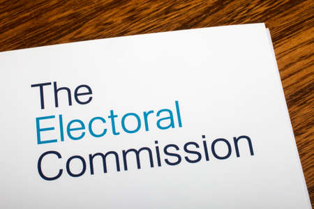 electoral: LONDON, UK - JUNE 16TH 2016: The logo of The Electoral Commission on the top of an information booklet, on 16th June 2016.  The organization regulates party and election finances.