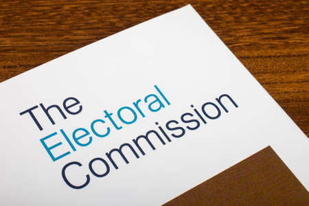 voter registration: LONDON, UK - JUNE 16TH 2016: The logo of The Electoral Commission on the top of an information booklet, on 16th June 2016.  The organization regulates party and election finances.
