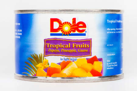 dole: LONDON, UK - JUNE 16TH 2016: A tin of Tropical Fruit in Light Syrup produced by Dole Food Company, taken on 16th June 2016. Dole Food Company Inc are based in California and are the largest producer of fruits and vegetables in the world.