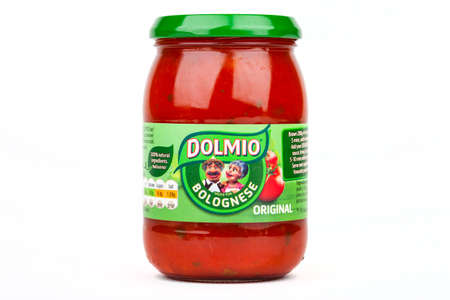 LONDON, UK - JUNE 16TH 2016: A jar of Dolmio Bolognese Sauce over a white background, on 16th June 2016.  Dolmio is a brand of Pasta Sauces made by Mars, Incorporated. Editorial