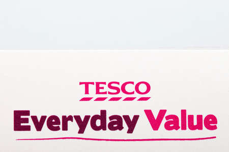 everyday: LONDON, UK - JUNE 16TH 2016: Close-up of the Tesco Everyday Value logo on one of their food products, on 16th June 2016.  It is common for major retailers to have their own value brand in an effort to compete on price. Editorial